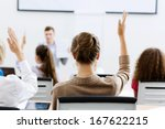 young teacher in classroom... | Shutterstock . vector #167622215