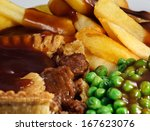 Close Up Of Steak Pie And Chip...