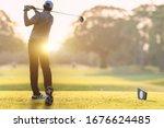 Golfer he's golfing in sunlight ...