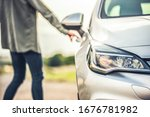 Modern silver car parking on the road. Close up. Concept for car rental. Thief Opening Car's Door. Stealing. - stock photo