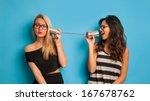blonde and brunette women... | Shutterstock . vector #167678762