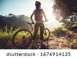 Young Woman Cyclist  Enjoy The...
