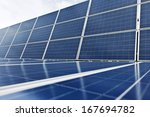 Blue Photovoltaic Cells or Solar Panels - stock photo