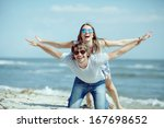 happy couple having fun on the... | Shutterstock . vector #167698652