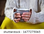 Hands Holding A Mug With Hot...