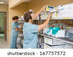 nurses arranging stock in... | Shutterstock . vector #167757572