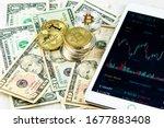 stacks of bitcoins on paper... | Shutterstock . vector #1677883408