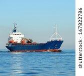 cargo ship sailing in still