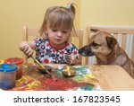 A Two Year Old Girl Painting A...