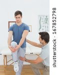 male therapist assisting young... | Shutterstock . vector #167852798