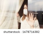 Small photo of Young woman in medical mask stay isolation at home for self quarantine. Concept home quarantine, prevention COVID-19, Coronavirus outbreak situation