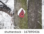 Red Tree House For Birds In Th...