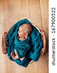 new born child in basket with... | Shutterstock . vector #167900522