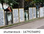 Small photo of Mandalay, Myanmar - December 27, 2011: The tablets with signs of gratuity to donors of the Mahagandayon Monastery