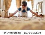 Hotel Maid In Uniform Making...