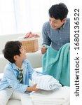 Parent and child folding laundry