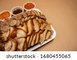 Small photo of Boiled pig's trotters with sauce (Jokbal). Famous Korean food, delivery food.
