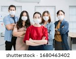 Small photo of asian small business startup multiracial fighting action posture with laptop and chart paper everyone mask for covid19 protection corona flu prevent healty ideas concept office background