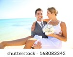 happy groom holding bride in... | Shutterstock . vector #168083342