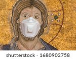 Small photo of Medical mask, protection against coronavirus and other viruses. the face of Jesus with nimbus