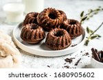 Chocolate Muffins On A White...