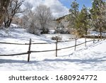 Wooden Fence In Snowy New Mexico