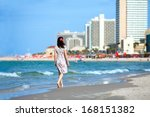 young woman walking on the... | Shutterstock . vector #168151382