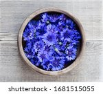 Cornflowers In A Wooden Bowl O...