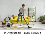 Happy Girl Cleaning Carpet With ...