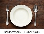 empty plate with spoon and fork ...   Shutterstock . vector #168217538