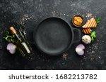 Black Frying Pan On Stone...