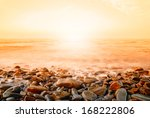 Seascape With Orange Sky At...
