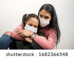 Latin Mother And Daughter Hug...