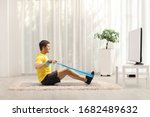 Young Man Exercising With An...