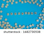 """Small photo of Self Isolation prevent infection concept. Letter on wooden blocks arranged in word """"Isolation"""" with space between letters imply to practice social distancing protect from COVID-19 coronavirus"""