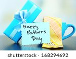 happy fathers day tag with gift ... | Shutterstock . vector #168294692