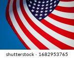 Backlit American Flag Curving...