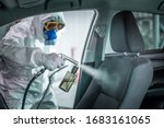 Small photo of Clean surfaces in car with a disinfectant spray. Help kill coronavirus in car after going out.