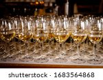 Row Of White Wine In Glasses.