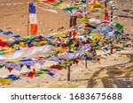Small photo of Colorful prayer flags with mantra 'Om Mani Padme Hum' in Sanskrit meaning compassion, ethics, patience, diligence, renunciation and wisdom in English flying in winds at Kunzum pass in Himachal Pradesh