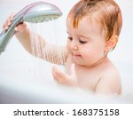 cute 1 year old girl bathes in... | Shutterstock . vector #168375158