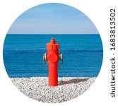 Small photo of An improbable hydrant at the seaside - Plenty of water concept image - Round icon concept image - Photography in a circle