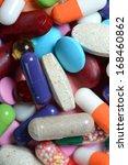 pills isolated on white... | Shutterstock . vector #168460862