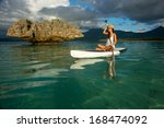 young beautiful girl surfer... | Shutterstock . vector #168474092
