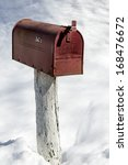 Red Rural Mailbox In The Snow...