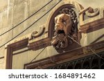 A Lion\'s Head Sculpted In Ston...