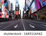 Small photo of Manhattan. New York / USA - March 26 2020: Empty streets of New York at Times Square 42nd street during pandemic virus Covid-19