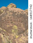 petroglyphs on the stone in... | Shutterstock . vector #168517742