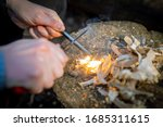 Outdoors Makeing Fire By Flint