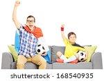 two male sport fans sitting on... | Shutterstock . vector #168540935